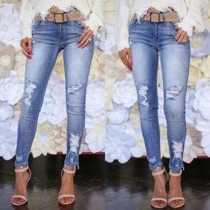 BRYNN Distressed Light Wash Skinny Jeans